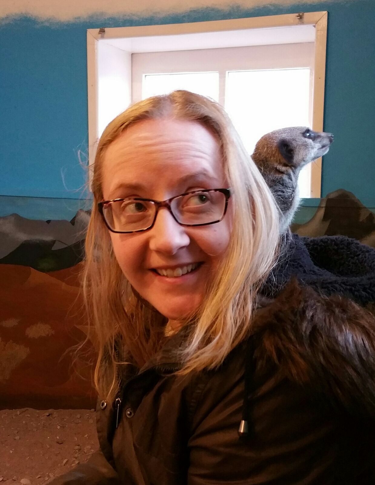 lady with meerkat on shoulder